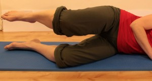 side-lying, knees bent, lifting top leg
