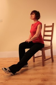 Sitting forwards with one leg long at start of stretch