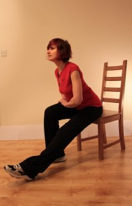 Sitting forwards with one leg long for stretch