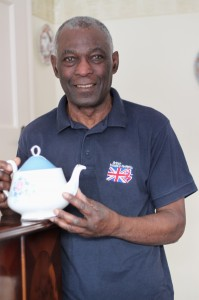 Charlie Williams holding his prize teapot