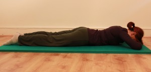 Lying face down, activating lower abs muscle for basic strengthening