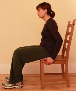 Sitting incorrectly with back hunched over