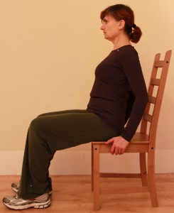 Sitting incorrectly, leaning backwards
