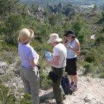 Three women on a walk admire beautiful views in France, by Sabrina